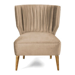 EcoFirstArt - Bakairi Armchair - 'Sons of the Sun,' the Bakairi Indians of Brazil are a creative people and the inspiration for this elegant, ecofriendly armchair. Shown in a sumptuous caramel beige silk velvet fabric, you can choose the wood and upholstery you fancy. Gilded legs add a regal air to a chair meant to bridge the divide between the gods and the mortal world.