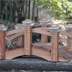Redwood Garden Bridges - Redwood Short Post 4-ft. Garden Bridge - 4FTSHORTPOST - Shop for Gates and Bridges from Hayneedle.com! Finely crafted the Redwood Short Post 4-ft. Garden Bridge has 6 posts capped with Redwood ball finials or optional copper solar-powered lights. Single arch rails link the posts together. This garden bridge is an elegant addition to your yard or garden making a great accent to landscapes or placed over a koi pond running stream rock river bed and flower beds. Strong and sturdy it's hand-crafted from 100% hand-selected California Redwood and is available sealed or unsealed. Weather-resistant galvanized hardware is used and all pieces are pre-sanded and pre-drilled. Sections of the bridge even arrive pre-assembled. The remaining assembly is easy requiring minimal tools and time.