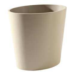 Barbara Barry Elegant Oval Bin - A restrained hue inspired by Venetian plaster is solidly rendered for a discreet designer style in the Barbara Barry Elegant Oval Bin.  A sleek piece with a narrow form, simplified outlines, and a slight flare so that it fits neatly against your desk or beside your vanity, the small designer receptacle works as either a basket for organizing a wastebasket for keeping your space neat � its lines continuing a pared-down style without drawing the eye.