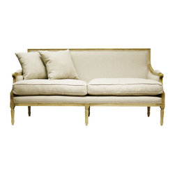 Kathy Kuo Home - St. Germain French Country Natural Oak Louis XVI Natural Linen Sofa - Overstuffed cushions lend an informal touch to this elegant Louis XVI style sofa. Upholstered in natural linen, its natural oak frame and fluted legs are embellished with decorative carvings. Set of 4 pillows included (2 larger pillows not shown here).