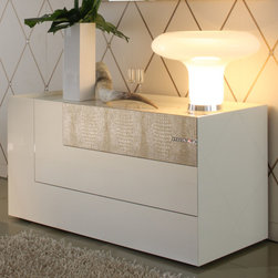 Rossetto - Diamond Ivory Dresser - The sightly off-centered lines are what provide the originality to this stylish ivory bedroom dresser. The high gloss lends to its contemporary feel while the textured faux crocodile that's strategically placed provides a sharp look you won't find in another collection. Diamond is a refined collection with precious new details: inserts in crocodile leather effect, inlays and components in genuine Strass Swarovski Crystals that highlight the splendor of gloss black and ivory lacquers, adding a touch of luxury to the formal elegance of this collection.