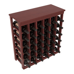36 Bottle Kitchen Wine Rack in Redwood with Cherry Stain + Satin Finish - A small wine rack with big storage. This wine rack kit is the best choice for converting tiny spaces into big wine storage. The solid wood top excels as a table for wine accessories, small plants, and wine collectables. Store 3 cases of wine properly in a space smaller than most entry tables!