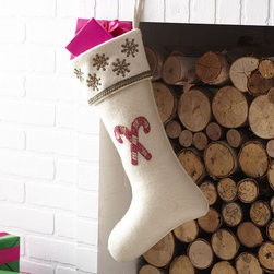 A MERRY LITTLE STOCKING – CANES - NEW - Hang from the chimney with care—these stockings are ready to be filled with cheer! Spruce up your holiday home with this classic design. Hand-beaded and wool lined with satin, this chimney charmer is trimmed with a snowflake pattern along the top rim with a part of the holly jolly spirit in the center—bring good tidings to your décor (and you!).