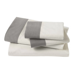 DwellStudio - DwellStudio Modern Border Smoke Sheet Set - A bold stripe packs DwellStudio's Modern Border sheets with a contemporary punch. The white and smoke gray set's contrasting aesthetic maximizes the bed with soft comfort and of-the-moment style. Available in full, queen and king; 100% supima cotton, 400 thread count; Set includes flat sheet, fitted sheet and 2 pillowcases; Inserts not included; Machine wash