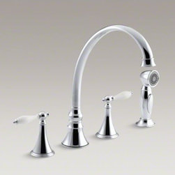 """KOHLER - KOHLER Finial(R) 4-hole kitchen sink faucet with 9-3/16"""" spout, matching finish - The classic detailing and graceful arch of this Finial Traditional kitchen faucet portrays a timeless look. Ergonomic lever handles feature white ceramic inserts for an elegant, vintage-inspired accent. The high-arch swing spout and sidespray provide both"""