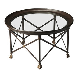 Butler Specialty - Butler Richton Glass and Metal Cocktail Table - This dramatic Cocktail Table features a round glass top framed in metal finished in a rich brown and supported by a matching base in a pentagon of legs bound by dramatic X's highlighted with golden medallions and shapely golden feet.