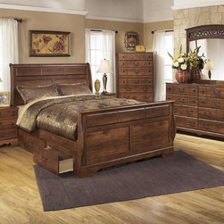 Signature Design by Ashley - Signature Design by Ashley Timberline Queen-size Warm Brown Sleigh Storage Bed - Several lower storage drawers make the Timberline bed a convenient and stylish addition to any bedroom decor. Crafted with wood and finished in warm brown,this handsome bed is complete with a scrollwork border on the headboard.