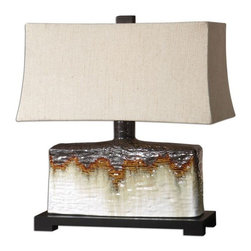 Uttermost - Adelanto Ceramic Table Lamp - Textured ceramic base finished in an antiqued ivory glaze with a metallic dark bronze and rusty orange drip.