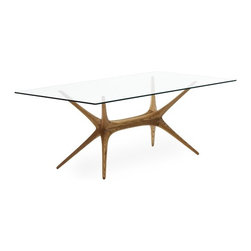 X-Frame Glass Top Table - Originally designed in 1958 by Tapio Wirkkala, this stunning glass top dining table was recently reissued by Artek. The wood legs are a sculptural work of art, and the transparent top lets them stand out in all of their mid-century glory.