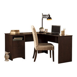"Bush - Bush Buena Vista 60"" L-Shaped Desk in Madison Cherry - Bush - Home Office Desks - MY1383003 - Get style craftsmanship and a distinctive contemporary look for home or corporate offices. All are standard with the Bush Furniture Buena Vista Madison Cherry 60"""" L-Desk. Full functionality in a compact footprint works anywhere. Expansive surface offers plenty of room for equipment and papers. Lets you spread out projects comfortably. Accepts and securely attaches to 60"""" Hutch. Pedestal has open storage a box drawer and a file drawer. Single box drawer holds supplies while other drawer accepts letter-size files. Open storage cubby organizes papers and keeps important work close at hand. Elegant post leg design and curved base-rails accented by aged bronze-metal drawer hardware adding a posh touch to any decor. Long-term value with rugged solid surfaces and attractive finish stands up to punishment and retains its good looks. Backed by the Bush Furniture 1-year Manufacturer's Warranty."