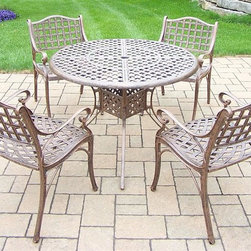 Oakland Living - 5-Pc Outdoor Dining Set - Includes table and four dining chairs. Fade, chip and crack resistant. Traditional lattice pattern. Metal hardware. Warranty: One year. Made from rust-free cast aluminum. Antique bronze hardened powder coat finish. Minimal assembly required. Table: 42 in. Dia. x 29 in. H (44 lbs.). Chair: 22.5 in. W x 22 in. D x 35 in. H (24 lbs.)This 5 piece dining set is the prefect piece for any outdoor dinner setting. Just the right size for any backyard or patio. 42 inches diameter table top and has opening hole for an umbrella. The Oakland elite collection combines old world charm and modern designs giving you a rich addition to any outdoor setting. Each piece is hand cast and finished for the highest quality possible.