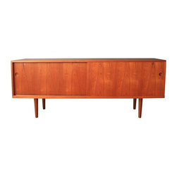 Used Hans Wegner Danish Modern Sideboard - What's a modern home without a fabulous vintage credenza? This is a vintage Mid-Century sideboard or credenza by Hans Wegner for Ry Mobler, Model 26. The sliding doors open to reveal adjustable white oak shelves and drawers. Great original condition with minor vintage wear such as a few faint marks on the top and a few small scratches. Please contact Support for more photos.