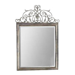 """Uttermost Kissara Metal Mirror - An open, forged metal top with curled flourishes and leaf details finished in warm, tarnished silver. Hand forged metal frame with an open design of curled flourishes and leaf details finished in warm, tarnished silver. Mirror features a generous 1 1/4"""" bevel. Matching console table is item #24347."""