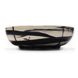 Gail Garcia Dinner-Ware - Medium Low Bowl, Black Ribbons - This hand-painted earthenware bowl is like a work of art for your tabletop. The bold, abstract brushstrokes dancing across the surface are courtesy of New York artist Gail Garcia, who instills each piece with a dynamic sense of power. Whether filled with food or displayed on a shelf, it's sure to earn raves.