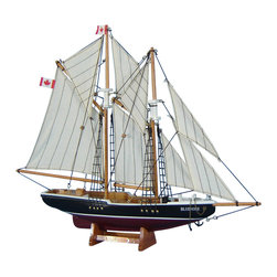 "Handcrafted Model Ships - Bluenose 17"" - Wooden Sailboat Centerpiece - Not a model ship kit. Attach sails and Bluenose model sailing yachts are Ready for Immediate Display. Inspired by the iconic Canadian schooner Bluenose, this adorable twin-masted sailing boat model is the perfect accent for any nautical themed room. Both a celebrated racing yacht and hard-working fishing boat, the Bluenose is an ideal nautical decor accent for a child's bedroom or family living room while inspiring a proud and winning ""can-do"" spirit to any office or boardroom. 17"" Long x 3"" Wide x 14"" High (1:113 scale)."