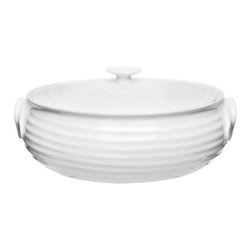 Portmeirion - Sophie Conran White Individual Covered Serving Dish - 491854 - Shop for Drinkware from Hayneedle.com! The Sophie Conran White Individual Covered Serving Dish was made for potlucks and dinner parties. Crafted of durable porcelain this versatile dish was designed to go from oven (or microwave) to table. Cleanup is easy simply pop it in the dishwasher. Just make sure to take it when you go. Everyone will want this dish!About PortmeirionStrikingly beautiful eminently practical refreshingly affordable. These are the enduring values bequeathed to Portmeirion by its legendary co-founder and designer Susan Williams-Ellis. Her father architect Sir Clough Williams-Ellis was the designer of Portmeirion the North Wales village whose fanciful architecture has drawn tourists and artists from around the world (including the creators of the classic 1960s TV show The Prisoner). Inspired by her fine arts training and creation of ceramic gifts for the village's gift shop Susan Williams-Ellis (along with her husband Euan Cooper-Willis) founded Portmeirion Pottery in 1960. After 50+ years of innovation the Portmeirion Group is not only an icon of British design but also a testament to the extraordinarily creative life of Susan Williams-Ellis.The style of Portmeirion dinnerware and serveware is marked by a passion for both pottery manufacturing and trend-setting design. Beautiful tactile nature-inspired patterns are a defining quality of Portmeirion housewares from its world-renowned botanical designs modeled on antiquarian books to the breezy natural colors of its porcelain and earthenware. Today the Portmeirion Group's design legacy continues to evolve through iconic brands such as Spode the Pomona Classics collection and the award-winning collaboration of Sophie Conran for Portmeirion. Sophie Conran for Portmeirion:Successful collaborations have provided design inspiration throughout Sophie Conran's life. Her father designer Sir Terence Conran and mother food writer Caro