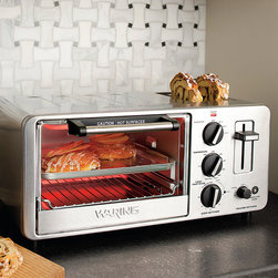 Frontgate - Waring Pro Toaster Oven and Toaster - 1,500-watt oven heats up to 450°F. Integrated 2-slice toaster features a specialized bagel setting. 30-minute timer ensures your food is cooked to perfection. Brushed stainless steel front panel. 2' cord. With the space-saving convenience of the Waring Pro Toaster Oven and Toaster you can bake, broil, or toast your favorite foods in one attractive countertop appliance. Enjoy delicious, oven-fresh flavor without the unpleasant sogginess caused by microwave cooking. 1,500-watt oven heats up to 450 degreesF. . . . . 120V.