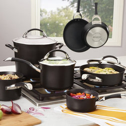 Circulon - Circulon Symmetry Cookware Set - Black - 82983 - Shop for Cookware Sets from Hayneedle.com! Cooking is sometimes a joy and sometimes a responsibility but no matter how you see it there's no reason to do it with anything less than the Circulon Symmetry Cookware Set - Black. Each pot or pan in this complete everyday set features an impact-bonded stainless steel base suitable for all stovetops including induction. Heavy gauge hard-anodized aluminum gives you a robust body while DuPont's innovative non-stick system the Autograph 3 uses a system of subtly raised circles and non-stick coating to release your food easily and completely every time. It also makes this essential set very easy to clean and is safe for use with metal utensils. Tempered glass lids with stainless steel trim let you see how your work is progressing and each piece in this set is dishwasher-safe and can be placed in ovens up to 400 degrees with the cookie sheets topping out at a very practical 500 degrees F.This set includes:2-qt. covered saucepan&#443-qt. covered saucepan&#448-qt. covered stockpot&#4410-in. open skillet&#443-qt. covered saute&#44 2 cookie pansAbout CirculonCirculon's gourmet nonstick cookware is engineered to make home cooking fast easy healthy and delicious. In 1985 Circulon revolutionized the industry by introducing the first hard-anodized nonstick cookware. Their patented TOTAL Food Release System creates Circulon's signature circular groove pattern on the cooking surface which reduces the amount of nonstick that comes into contact with cooking utensils for reduced abrasion and superior durability. Combined with the most advanced nonstick coating from DuPont this innovative technology is also dishwasher-safe and induction-suitable. New cooks and seasoned chefs alike will be satisfied with Circulon cookware for a lifetime - guaranteed.