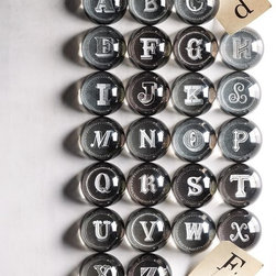 """Alphabet Letter Paperweights - While I'm tempted to get one of these paperweights with my initial emblazoned underneath, I think a big """"B"""" might be more fitting, as I plan on using one to pin down all incoming household bills in one place on my desk."""