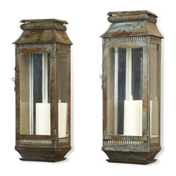 Kathy Kuo Home - Modena Tall Moroccan Rustic Pair Wall Sconce Lanterns - Evoking the look and feel of relics from an old French Colonial mansion, this stylish pair of wall sconces create a very strong impression whether lit or not.  With a verdigris patina on iron, and old-world venting details at the bases and tops, the beauty of candlelight is almost upstaged by the sconces themselves. Recommended to be always wall mounted.