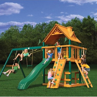 Gorilla Playsets - Gorilla Playsets Blue Ridge Chateau II Wood Swing Set - 01-0003 - Shop for Swings Slides and Gyms from Hayneedle.com! Additional featuresTongue in groove wood roofSafety step ladderRock-climb wall with knotted rope2 swings and trapeze bar with ringsPoly-coated pine beams and powder-coated chains4 x 6-in. swing beamIron ductile swing hangers4 x 6-ft. play deck4 x 4-in. framing5-ft. H deckClimbing rope ladder2 swings and trapeze bar w/ powder-coated chains10-ft. green wave slideTelescope for imaginative playBuilt-in picnic tableBuilt-in sandboxAll necessary hardware is included The Gorilla Playsets Blue Ridge Chateau II Wood Swing Set enjoys its status among the few wood-roofed play sets we offer. Access to the large deck of the fort can be achieved via a rope ladder rock wall or safety ladder.Everyone worries about the safety of their children when it comes to swing sets. Pinched fingers and slippery surfaces are the standard at most playgrounds but you'll be relieved to know that the Blue Ridge Chateau II swing set comes with super sturdy plastics and powder-coated chains that don't tangle or pinch. And there is little room for error when assembling as all your lumber has been cut drilled and sanded beforehand.And don't be discouraged if you aren't a handy carpenter. Putting it together is easy fun and can be done in about seven hours. Plus since this swing set design is free-standing you won't find yourself digging support holes or planting stakes that may loosen. The pine beams are maintenance-free and poly-coated so they are very durable. A step-by-step 3-D illustrated instruction booklet is included and construction can be completed in about seven hours.About Gorilla PlaysetsSince 1992 Gorilla Playsets has been designing and selling ready-to-assemble playsets. With a reputation for providing excellent customer service Gorilla Playsets conveniently provides customers with affordable playsets including quality wood components sturdy playset acce