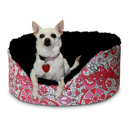 """Snoozer - Snoozer Dog Couch - 70100 - Shop for Beds Covers and Fill from Hayneedle.com! The Snoozer Pet Couch gives your pet a comfortable protective feeling as they rest and sleep. This pet couch features a lambskin interior and is available in solid colors as well as plaids. The couch cover is removable and washable for easy care. High side walls complement the wonderful poly/cotton fabric. Snoozer Pet Couch Dimensions: Small: 18L x 14W x 7H inches Medium: 23L x 18W x 10H inches Large: 27L x 23W x 10H inches X-Large: 32L x 27W x 10H inches XX-Large: 41L x 31W x 11H inches About SnoozerNorman O'Donnell wanted something better for his dogs but found that pet shops didn't sell such products. So in 1985 he established O'Donnell Industries to manufacture Snoozer Pet Products. Today O'Donnell offers customers a profusion of quality pet products. Because today's pets are considered """"part of the family """" Snoozer Pet Products are designed to blend easily with almost any home decor. The company's indoor products are crafted from upholstery-grade fabrics available in a multitude of colors and patterns that will keep your animals stylishly warm and comfy."""