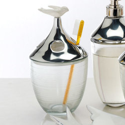 """Lunares - Paloma Toothbrush Holder - Overview Organize and beautify your bathroom with this charming bath accessory. Toothbrush holder features an enamel bird perched on top. Features Silver aluminum alloy Birds are crafted from proprietary porcelain enamel on top of metal   Specifications  Hand wash with non-abrasive soap and water, towel dry Toothbrush Holder  8"""" wide x 4"""" high x 4"""" wide"""