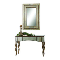 Uttermost Almont Mirrored Console Table - Distressed rust bronze finish with silver champagne undertones and antiqued beveled mirror inlays. Distressed, rust bronze finish with silver champagne undertones and antiqued, beveled mirror inlays. Features one pull out drawer. Matching mirror is item #8099.