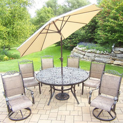 Oakland Living - 9-Pc Outdoor Aluminum Dining Set - Includes table, two swivel rockers, four dining chairs, 9 ft. tilt crank umbrella with stand and metal hardware. Fade, chip and crack resistant. Traditional lattice pattern and scroll work. Rust free and handcast. Hardened powder coat. Warranty: One year limited. Made from sling. Coffee color. Minimal assembly required. Table: 60 in. Dia. x 29 in. H (70 lbs.). Dining chair: 24 in. W x 30.5 in. D x 40 in. H (12 lbs.). Swivel chair: 24 in. W x 30.5 in. D x 40 in. H (16 lbs.)The Oakland Cascade Collection combines contemporary style and modern designs giving you a rich addition to any outdoor setting.