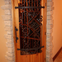Wine cellar door ornamental iron by architectural justice for Mediterranean interior doors