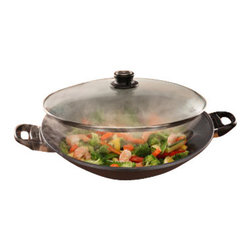 """Swiss Diamond - Nonstick Wok with Lid - 14"""" - Cook for the whole family like a Chinese pro with our largest Nonstick Wok. Swiss Diamond has spent years working on their high quality wok design. At 14 inches in diameter, this 6.3 quart wok is made from heavy duty cast aluminum, eliminating the need for a wok ring, and coated with our patented diamond-reinforced coating. This oversized wok is perfect for cooking stir-fry, lo mein, sesame chicken or any of your favorite Asian dishes, all without oil to keep your meals healthy. Our easy-to-clean nonstick coating means youll never have to scrub after making a delicious General Tsos chicken. This wok also includes a tempered glass lid, plus a bonus tempura rack for draining foods."""