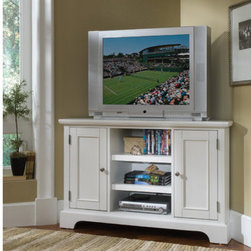 "Home Styles - Bedford 50"" Corner TV Stand - The Bedford Corner Entertainment Credenza is a wonderful addition to the room where an entertainment unit is necessary and a large amount of space isn't readily available. The credenza has two cabinets, each with two adjustable shelves, and a large open storage area with two adjustable shelves. The credenza is made from a hard wood solids and wood product with a multi-step ebony finish including a clear coat finish helping to guard against wear and tear stemming from normal use. Features: -Great space saving corner design.-Two cabinets with wood framed doors and adjustable shelves inside.-Open center area with adjustable shelves.-Accommodates up to a 47'' TV.-Convenient wire management opening.-Bedford collection.-Recommended TV Type: Up to a 42"" flat panel TV.-Powder Coated Finish: No.-Gloss Finish: No.-Material: Hardwood solids and engineered wood.-Distressed: No.-Exterior Shelves: Yes -Number of Exterior Shelves: 2.-Adjustable Exterior Shelves: Yes..-Drawers: No.-Cabinets: Yes -Number of Cabinets: 2.-Number of Doors: 2.-Door Attachment Detail: Hinges.-Magnetic Door Catches: Yes.-Cabinet Handle Design: Knobs.-Number of Interior Shelves: 2.-Adjustable Interior Shelves: Yes..-Scratch Resistant: No.-Hardware Finish: Brushed nickel.-Casters: No.-Accommodates Fireplace: No.-Fireplace Included: No.-Lighted: No.-Media Player Storage: Yes.-Media Storage: Yes.-Cable Management: Cable management opening.-Remote Control Included: No.-Batteries Required: No.-Swatch Available: No.-Commercial Use: No.-Collection: Bedford.-Eco-Friendly: No.-Recycled Content: No.-Lift Mechanism: No.-Expandable: No.-TV Swivel Base: No.-Integrated Flat Screen Mount: No.-Hardware Material: Brushed nickel hardware.-Non-Toxic: Yes.-Product Care: Clean with damp cloth.Specifications: -ISTA 3A Certified: Yes.-CARB Certified: Yes.-FSC Certified: Yes.Dimensions: -Overall Height - Top to Bottom: 32"".-Overall Width - Side to Side: 49.63"".-Overall Depth - Front to Back: 20"".-Shelving: -Shelf Height - Top to Bottom: 24.25"".-Shelf Width - Side to Side: 17.75"".-Shelf Depth - Front to Back: 16.5""..-Cabinet: Yes.-Overall Product Weight: 140 lbs.Assembly: -Assembly Required: Yes.-Tools Needed: Phillips screwdriver.-Additional Parts Required: No.Warranty: -Product Warranty: Vendor replaces parts for 30 days."