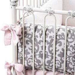 "Home Decorators Collection - Grace Crib Bedding - Lay your baby down to sleep in sweet style and soft comfort with our Grace Crib Bedding. These coordinated pieces are available as a set or individually. The two-piece Crib Bumper has a damask grey and ivory pattern on the outside; the snuggly inside is rendered in ivory. Open the bumper's convenient zipper closure to remove the polyester fill insert. The Oxford pink Crib Sheet has elastic all the way around for a secure fit. The Crib Skirt is ivory with a 3"" band of grey and ivory damask pattern. With an 18"" drop, it will add a finished look to your crib. 100% cotton. Each item fits a standard 52"" x 28"" crib. Three-Piece Crib Set includes Bumper, Sheet and Skirt. Bumper includes polyester fill insert. Spot or dry clean. Part of the Grace Nursery Collection. In accordance with city and state laws, Home Decorators Collection does not sell baby bumpers to consumers living in Maryland or Illinois."