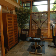 Contemporary Home Gym by Synthesis Design Inc.