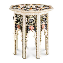 Aladdin Occasional Table - Recall the beauty of a summer holiday long the shore, a sojourn to seas unknown, a cottage beside wavelets speckled by the sun. The Aladdin Occasional Table mesmerizes with an array of shell patterns and formations that suggest flowers in full bloom. A beautiful radial pattern on the table top completes the entrancing appeal of the piece.