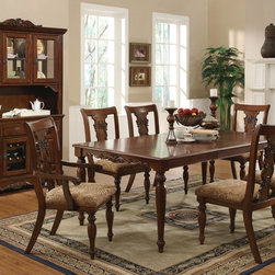 Home Furnishings - This beautiful formal dining table is the perfect centerpiece for your dinner parties or family gatherings. The scroll and floral designs on the table were carved out of birch veneers and finished with a rich cherry. The table features a classic arrow foot design, a fancy flourish for your formal dining table. The arm and side chairs feature carved urn backs and arrow feet. Chairs complement the rich cherry finish with tan upholstery in an arabesque pattern.