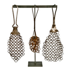 Salvatecture Studio - Set of Three Antique Chain Mail Pot Scrubbers on Stand #1 - You may think chain mail is only for knights, but think again! This one-of-a-kind piece features three antique chain mail pot scrubbers displayed on a reclaimed iron stand. It's certain to add a touch of vintage charm to any kitchen counter or when placed atop a shelf.