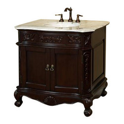 """Bellaterra - 34.6 In. Single Sink Vanity - Wood - Walnut - Carrara White Marble - Give your bathroom an upscale appearance with this handcrafted bathroom vanity, featuring smooth, rich finishes and a lustrous construction of wood. This bathroom cabinet will enhance your traditional bath decor with antique-style and classical appeal. Features intricate acanthus leaf details and scrolled feet. A beautiful 3/4""""thick hand-polished marble top completes the look. Vanity dimension: 34.6Wx23.6Dx36H * Birch* Medium walnut* Carrara White Marble* White Ceramic Sink* Antique brass finish hardware* Pre-drilled with 3 holes- 8 in. center faucet, Faucet and mirror not included* NO assembly required. Dimensions: 34.6 in. x 23.6 in."""