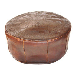 Pre-owned Vintage Latin American Leather Footstool Pouf - Beautiful hand tooled vintage leather foot stool / ottoman / pouf from Latin America.  Piece could possibly be Peruvian or Mexican with its Pre Colombian motif.  Extensive hand tooling leather work has went into this ottoman.  Can be stuffed with stuffing, blankets, or similar material for support.  Leather has scuffs and scratches from years of use.  There is a handle for easy carrying and the back ties with a leather strap for closure.