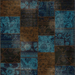 """Momeni - Vintage Indigo Southwestern 9'10"""" x 12'6"""" Momeni Rug by RugLots - Meant to emulate the over-dyed and patchwork handknotted rugs that are so popular today, Vintage interprets this look in a power-loomed quality with hand-sheared finishing that gives each design the look of a distressed, antiqued piece. Made of 100% NZ Wool. Due to the hand sheering of this product and in order to enhance the beauty of this collection each piece may vary slightly."""