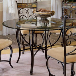 """Hillsdale Furniture - Round Glass-Top Dinette Table - This round glass table top is sure to please, and makes a tasteful addition to any dining room. The smooth glass top and elegantly curved metal legs will add a touch of class and grace that is complementary to any decor. A gracefully curved design and a polished glass top make this attractive table into a beautiful addition to any dining room. It's strong and durable, but not at the expense of its great looks��_a circle of artistic, colorful mosaic holds the glass surface up, completing this beautiful piece. * For residential use. This round glass table top is sure to please, and makes a tasteful addition to any dining room.. Smooth glass top. Elegantly curved metal legs. Black gold / slate mosaic base. 30H x 31.5W x 31.5D - 48"""" Diameter"""