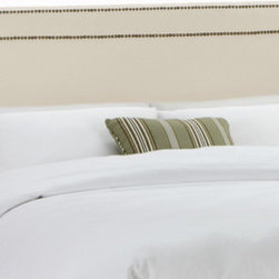 "Skyline Furniture - Nail Button Cotton Upholstered Headboard - Create a sleek and sophisticated look for your bedroom with this nail button border headboard. Upholstered in durable cotton, this headboard is highlighted with a double row of decorative brass nail buttons. It's constructed with plush foam padding for added comfort. Attaches to any standard bed frame. Features: -Nail Button collection. -Solid pine frame. -Metal leg. -Polyester fill foam. -Handmade. -Spot clean only. -Made in the USA. -1 Year limited warranty, excludes fabric. Dimensions: -Twin: 51"" H x 41"" W x 4"" D, 24 lbs. -Full: 51"" H x 56"" W x 4"" D, 31 lbs. -Queen: 51"" H x 62"" W x 4"" D, 33 lbs. -King: 51"" H x 78"" W x 4"" D, 45 lbs. -California King: 51"" H x 74"" W x 4"" D, 40 lbs."