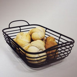 J & J Wire - Wire Serving Basket - Store apples and oranges on the counter serve bread at the dinner table or create an attractive repository for random junk with the multipurpose J & J Wire - Wire Serving Basket. This simple rectangular basket with handles is an attractive solution to a variety of decorating and storage conundrums. Proudly made in the USA from wrought iron with a black powder-coat finish this basket will last much longer than a wicker one and will complement country and contemporary homes alike.About J & J Wire Inc.Located at the Industrial Park in Beatrice Nebraska J & J Wire Inc. started 25 years ago as a wire-forming business manufacturing mostly houseware items. Since then the company has grown into a metal fabrication business serving customers in many different manufacturing sectors in the United States and Canada. From quilt racks to wine racks J & J Wire is committed to creating handmade works of art at affordable prices.