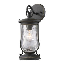 Elk Lighting - Farmstead Matte Black One-Light Outdoor Wall Light - -Lanterns have been widely used for portable lighting for hundreds of years until the time electricity reached rural farming areas.  Its simple design and function made it one of the most practical and widely used devices in history.  This series carries on this historic design style with clear water glass and period, authentic matte black finish. Elk Lighting - 43016/1