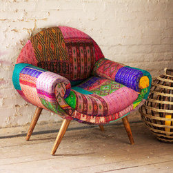 Calcutta Arm Chair - Take an armchair journey to India! Inspired by the kaleidoscopic jewel tones of the subcontinent and mid-century modern design, this upholstered armchair celebrates color and function. Each chair is unique, constructed using different and varied sets of cloth to create a one-of-a-kind piece.