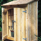 "Cedar Cubby with Arched Door - Keep gardening tools, clay pots, and lots more neatly out of sight in this handy kiln dried cedar shed. Double doors feature heavy galvanized strap hinges, Ring latch and chain bolt securing non-latch door. Screws together for easy assembly. Situate against a wall or anchor if freestanding (anchoring not supplied). Double doors each 24"" wide. 63 1/4"" W, 30 1/4"" D, 85"" H. Shipped Motor Freight."