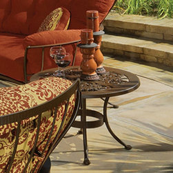 O.W. Lee - O.W. Lee Hacienda 24 in. Round End Table - OWLC651 - Shop for Tables from Hayneedle.com! Round out your patio seating ensemble with the two-piece O.W. Lee Hacienda 24 in. Round End Table. This set includes a curved-leg wrought-iron table base with a circular center support and a decorative round cast aluminum top. The top s intricate cut-out motif lets light pass through while stably supporting evening cocktails and weekend afternoon glasses of lemonade. Choose from a variety of rich finishes designed to coordinate with traditional outdoor pieces and withstand natural elements - alpine silver copper canyon dark bronze espresso graphite oxford white rosewood sable or textured black. Materials and construction:Only the highest quality materials are used in the production of O.W. Lee Company's furniture. Carbon steel galvanized steel and 6061 alloy aluminum is meticulously chosen for superior strength as well as rust and corrosion resistance. All materials are individually measured and precision cut to ensure a smooth and accurate fit. Steel and aluminum pieces are bent into perfect shapes then hand-forged with a hammer and anvil a process unchanged since blacksmiths in the middle ages. For the optimum strength of each piece a full-circumference weld is applied wherever metal components intersect. This type of weld works to eliminate the possibility of moisture making its way into tube interiors or in a crevasse. The full-circumference weld guards against rust and corrosion. Finally all welds are ground and sanded to create a seamless transition from one component to another. Each frame is blasted with tiny steel particles to remove dirt and oil from the manufacturing process which is then followed by a 5-step wash and chemical treatment resulting in the best possible surface for the final finish. A hand-applied zinc-rich epoxy primer is used to create a protective undercoat against oxidation. This prohibits rust from spreading and helps protect the final fi
