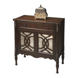 Butler Specialty Furniture - Heritage Console Cabinet 1137070 - Crafted from gmelina wood solids, wood products and choice maple veneers, this console cabinet features immaculately turned legs that extend all the way to the top and arresting silver-leaf treatments on door panels. Providing abundant storage with an adjustable shelf behind the doors, it boasts a lightly distressed walnut finish with antiqued edges. Antique brass finished hardware and one drawer with English dovetail construction. Only listed product included.