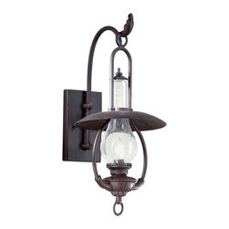 "Troy - La Grange Collection 20 1/2"" High Outdoor Wall Lantern - Get your outdoor patio or porch area in shape with this handsome lighting fixture from the La Grange collection. Features hand-forged metalwork a bent arm hook and antique lantern styling. Seeded glass adds to the rustic look. Old bronze finish. Takes one 60 watt bulb (not included). 20 1/2"" high. 9 1/2"" wide. Extends 11"" from the wall.  Old bronze finish.  Takes one 60 watt bulb (not included).   20 1/2"" high.  9 1/2"" wide.  Extends 11"" from the wall."