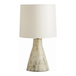 Arteriors - Earnest Lamp - Sometimes you need a lamp to simply complement your decor and not necessarily steal the show. In that case, the sophisticated and subtle glaze on this terra-cotta lamp is a clear winner. The ivory shade matches its base beautifully, and the overall look is sleek and chic.